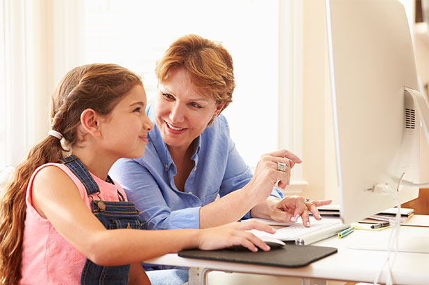 Grandmother Helping Granddaughter on Computer